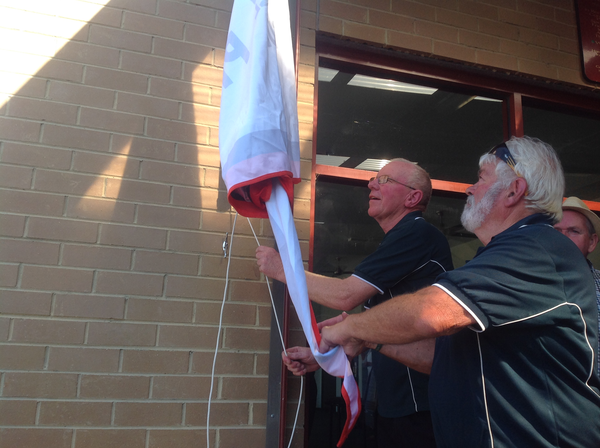 senior flag unfurl